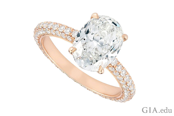 Engagement ring with an I-color 2.04 ct oval diamond center stone and 118 melee diamonds adorning the shank.
