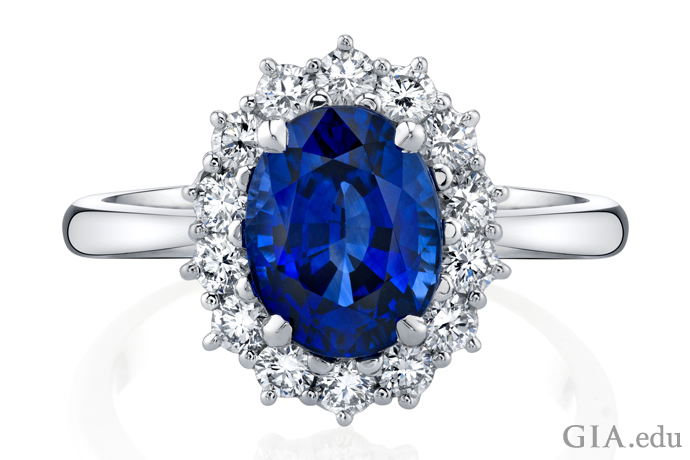A 2.73 ct oval sapphire engagement ring accented by 0.56 carats of diamonds.