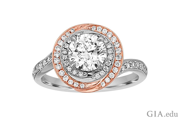 A 1.05 carat round brilliant cut diamond engagement ring with two halos of diamond melee set in 18K white gold and 18K rose gold.