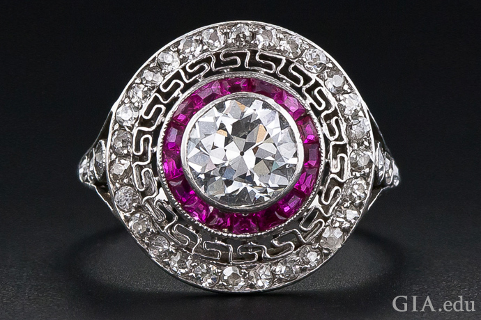 A ring of Burmese rubies encircles an Old European cut diamond in this Art Deco–era ring.