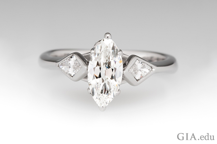 A G-color marquise diamond engagement ring set in white gold.