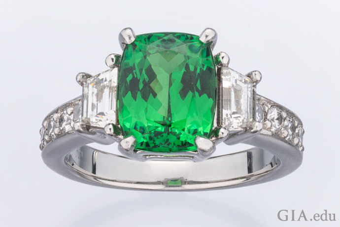 A 2.86 ct tsavorite ring with diamond accents, set in platinum.