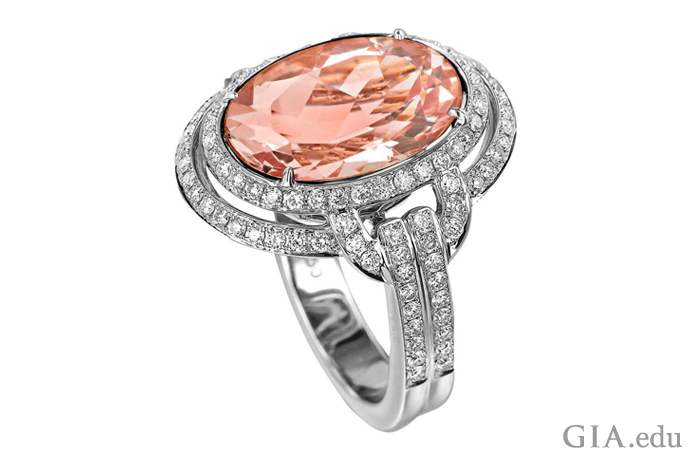 A 7.07 carat Art Deco style morganite cocktail set in18K white gold with a double-halo of diamonds.