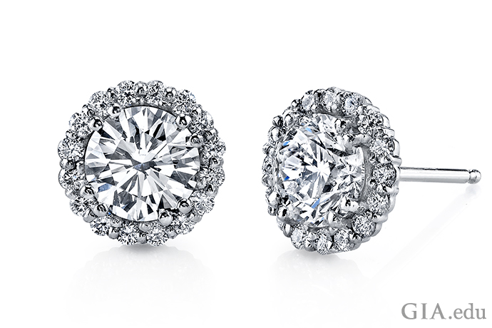 The more diamonds, the more sparkle. Surrounding a round brilliant cut diamond with a halo of diamond melee means more bejeweled fireworks from one of the most popular cuts for diamond stud earrings.