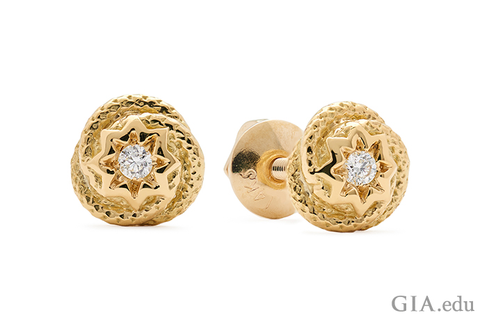 A snake motif encircles the diamonds in these stud earrings. It's a look that would wear well on a man or woman. And the studs wouldn't be appreciably heavier if they were made of platinum.