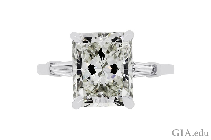 A 5.07 carat radiant cut diamond engagement ring with two baguette cut diamond side stones, set in 14K white gold.