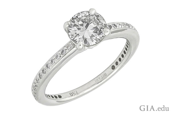 Round brilliant cut diamond engagement ring set in white gold, with a quality stamp of 750 ppt.