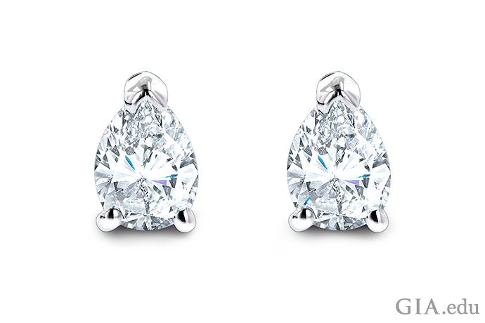 Three white gold prongs on the pear shaped diamonds in these stud earrings give full rein to the sparkle of the gems while holding them securely in place .