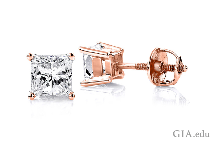Two 0.50 ct Princess cut diamonds star in these diamond stud earrings. They are set in rose gold, creating a bold contrast with the colorless diamonds.