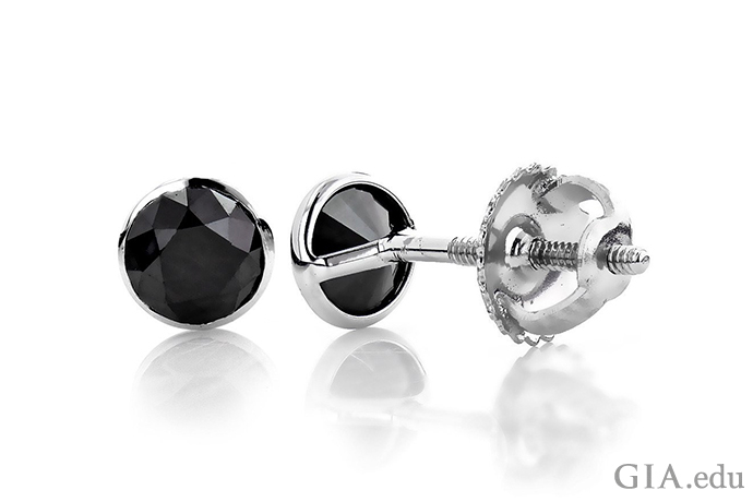 A 0.40 ct black diamond is well protected in a bezel setting with a screw-back post to hold it securely on the ear. These studs have undeniable masculine appeal.