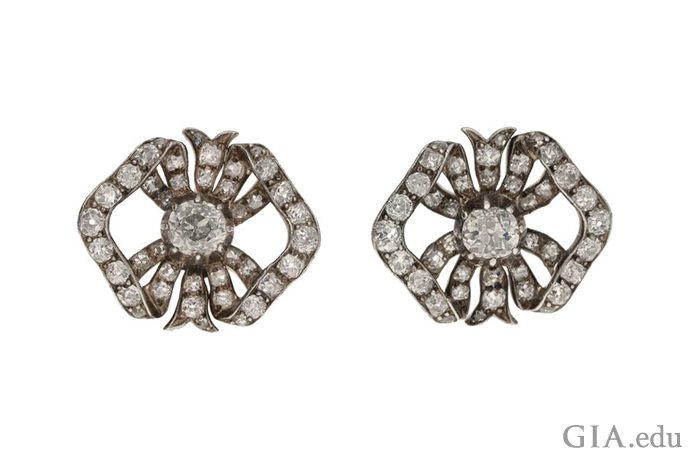 These antique diamond stud earrings have a timeless appeal. Each earring resembles a bow and together they glitter with 2.04 carats of diamonds.