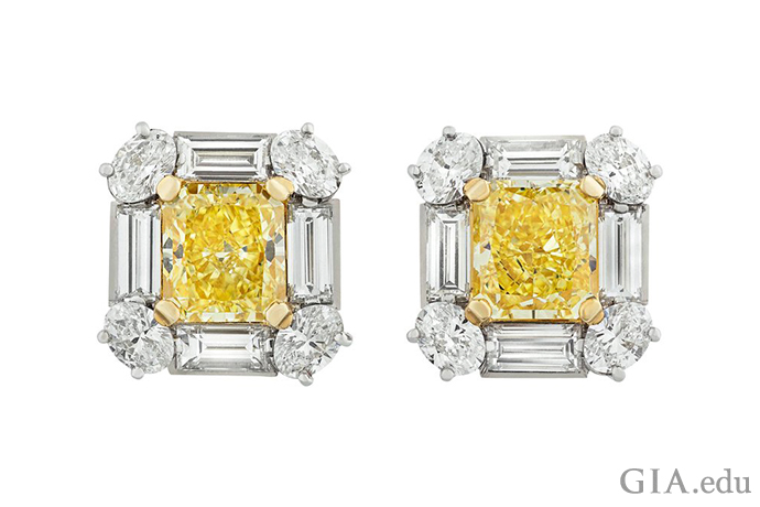These dressy diamond stud earrings feature 4.18 carats of Fancy Intense yellow diamonds framed by 3.49 carats of colorless diamonds. It's a look that won't easily be forgotten.