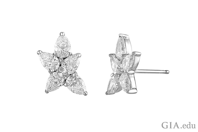 The delicate beauty of a snowflake twinkles in these diamond stud earrings. Ten pear shaped diamonds weighing a total of 2.48 carats make the design.