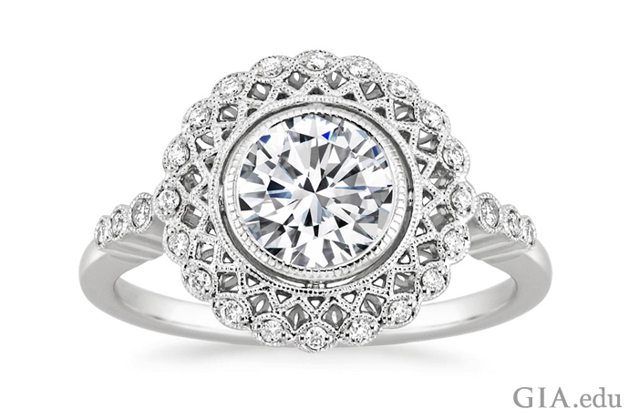 Edwardian style diamond engagement ring with milgrain and latticework detail.