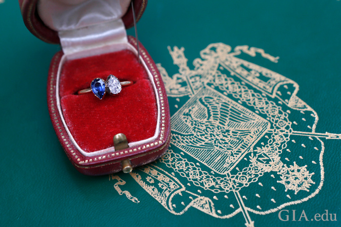 The Empress Josephine toi and moi engagement ring featuring a 1 carat pear shaped sapphire and diamond mounted in 18K gold.
