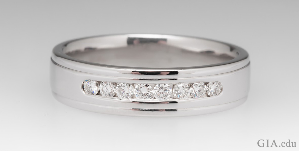 Mens wedding band with channel set diamonds.