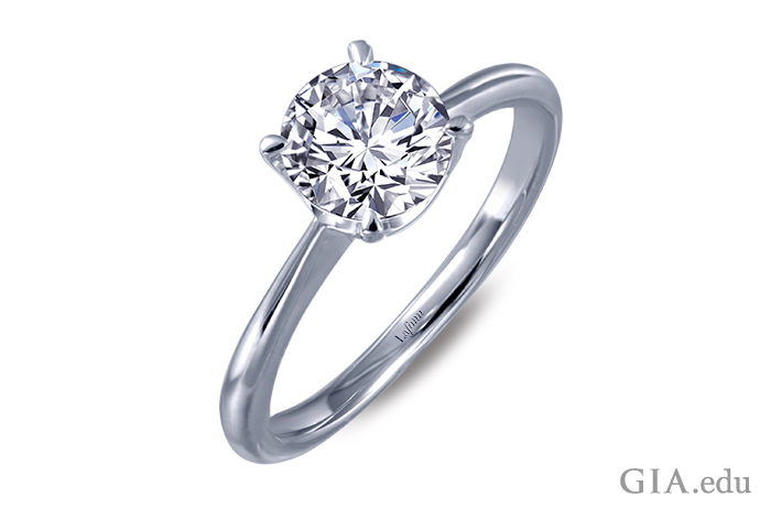 The stone in this ring is a diamond simulant, so it should be comparatively affordable. When finances permit, you can upgrade the center stone to a natural diamond. Courtesy: Lafonn