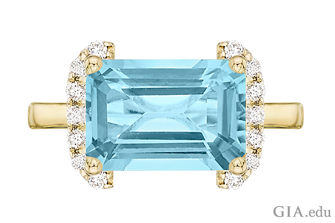 An emerald cut blue topaz ring set in 18K gold.