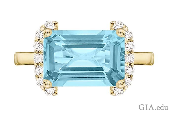 An emerald cut blue topaz ring set in 18K gold.