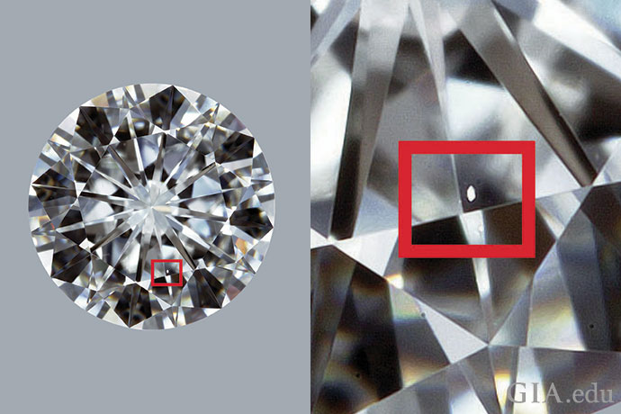 A diamond with a VVS1 clarity grade. The red box surrounds a small feather that is very difficult to see face-up at 10× magnification.