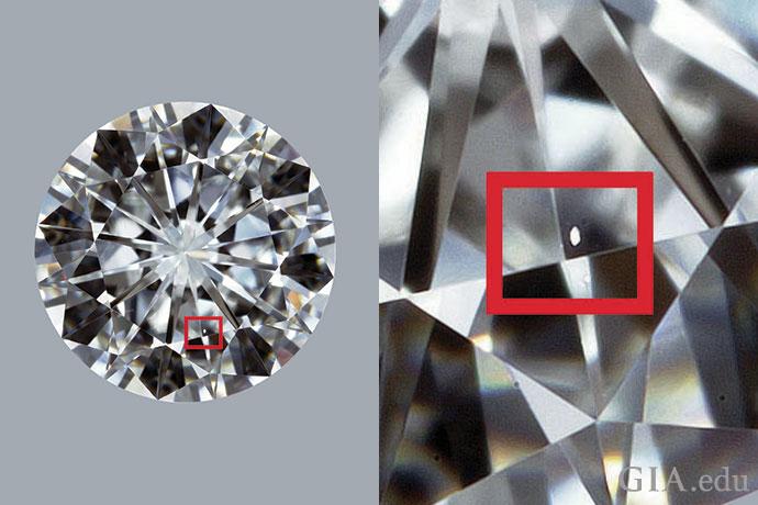 一颗净度等级为 VVS1 的钻石。在 10 倍放大镜下观察,红框中的小羽裂纹很难从正面看到。
