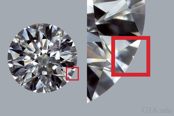 一颗净度等级为 VVS2 的钻石。在 10 倍放大镜下观察,红框中的微小羽裂纹很难从正面看到。