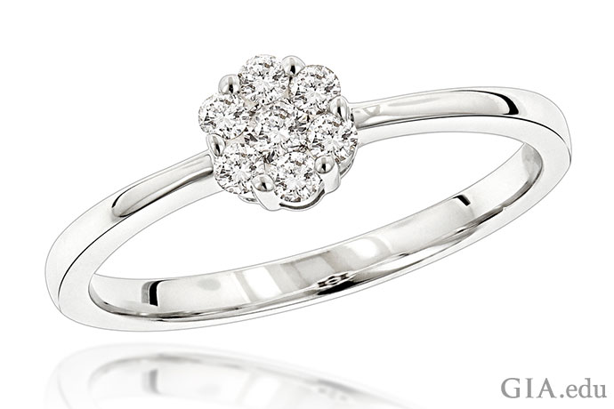 A 14K white gold ring featuring seven small diamonds weighing 0.22 total carats.