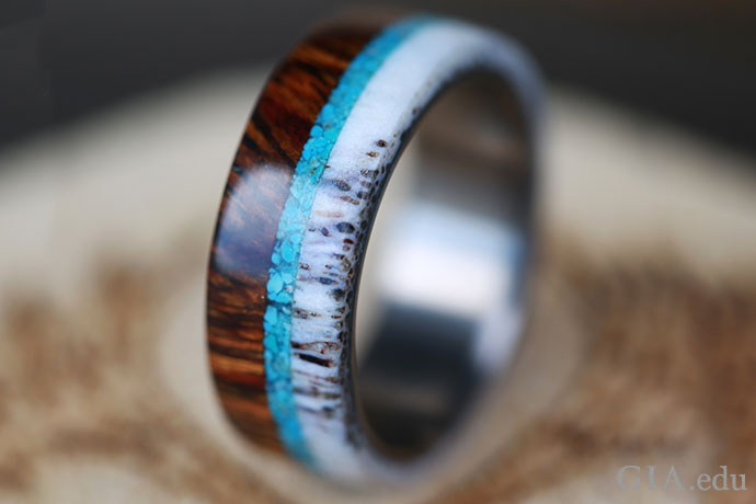 A placeholder ring band featuring ironwood, elk antler and turquoise.