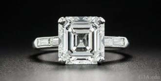 A 3.30 carat Asscher cut, H color diamond engagement ring.