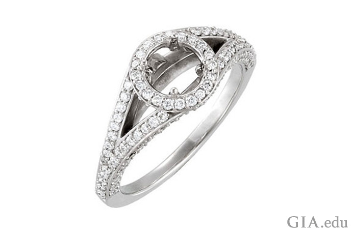 A semi mount ring accented with diamonds in the halo and in the split shank.