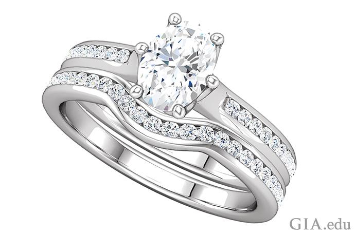 シャンクにチャネルセットのダイヤモンドメレーが飾られたダイヤモンドの婚約指輪と、そろいの結婚指輪のバンド。