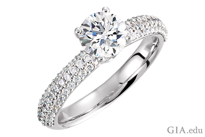 A semi mount ring set with diamond pavé and a round brilliant cut center stone.