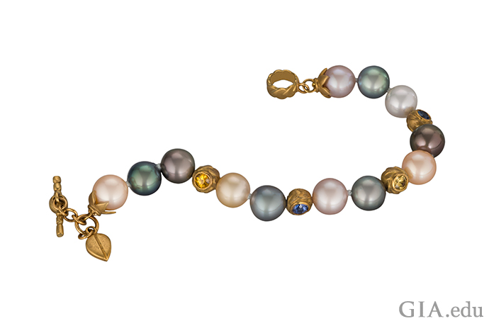 Multicolored cultured pearl bracelet with fancy sapphire roundels.