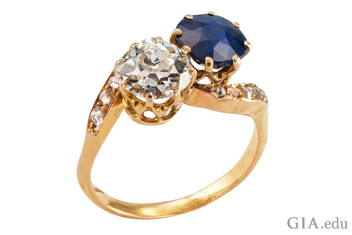 A Victorian era diamond and blue sapphire engagement ring.