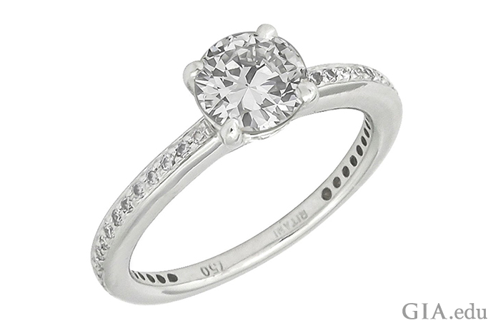A round brilliant cut engagement ring featuring diamond melee on the shank.