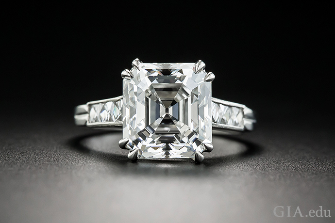 A 3.30 ct Asscher cut diamond engagement ring flanked by four baguettes.