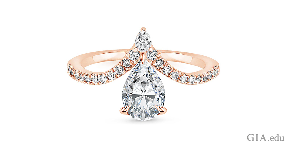 Chevron style pear shaped diamond engagement ring with melee diamonds lining the band.