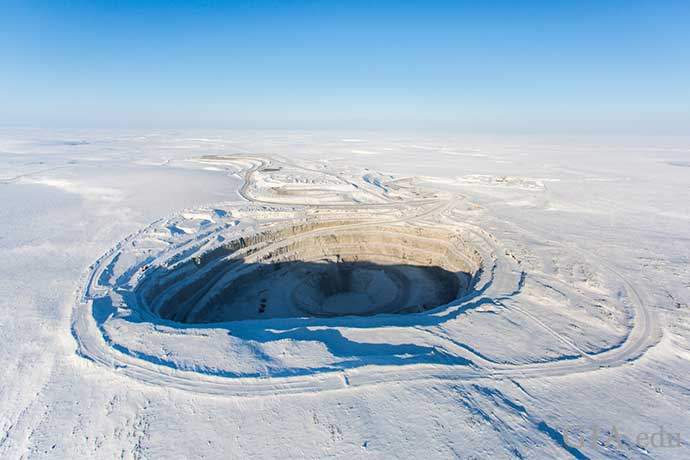 A diamond mine in northern Canada surrounded by frozen tundra.