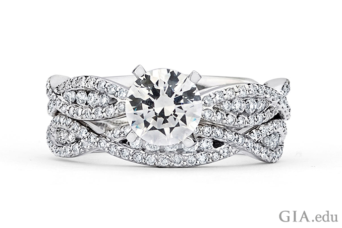 A round brilliant cut diamond engagement ring with intertwining rows of diamond melee.