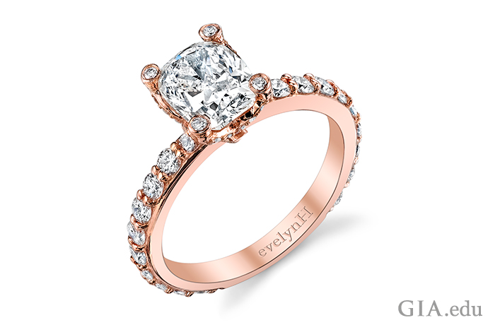 Rose gold diamond engagement ring accented with diamonds in the shank.