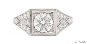 A 1.05 ct round brilliant cut diamond engagement ring set in an antique style.