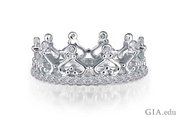 A crown-motif eternity ring set with simulated diamonds in sterling silver bonded with platinum.