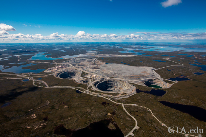 An aerial view of the Ekati Diamond Mine surrounded by lakes.
