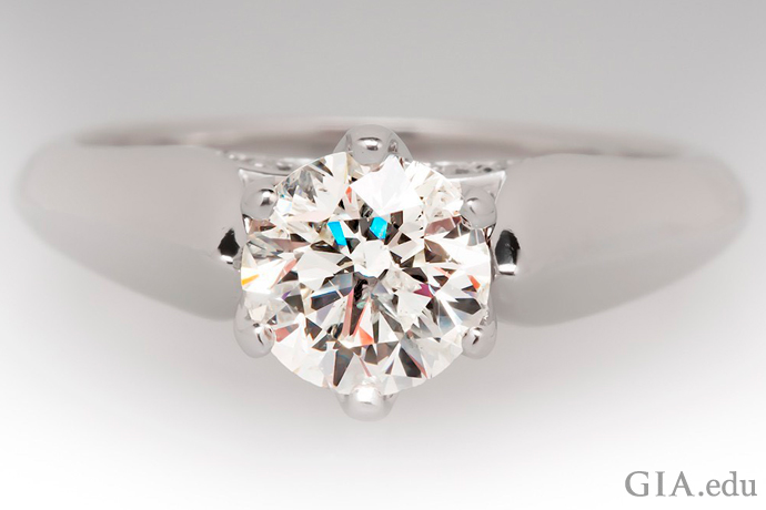 A 1.05 carat round brilliant diamond engagement ring laser inscribed with the Canadian Goose Diamonds logo.