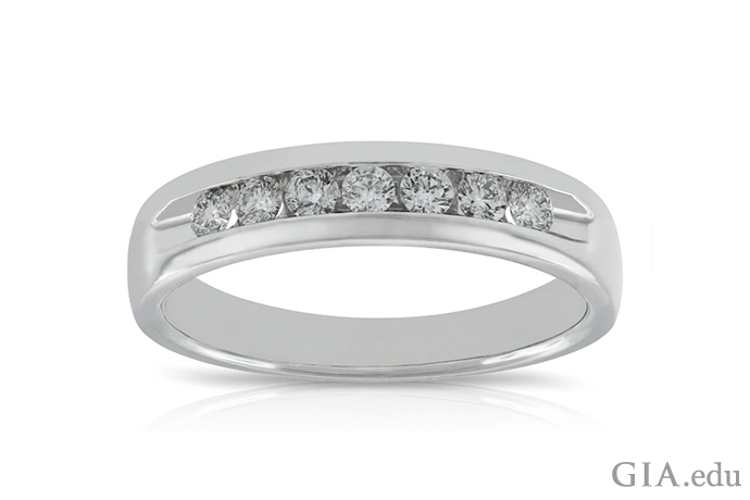 A white gold and diamond ring that can double as a wedding band for men or women.