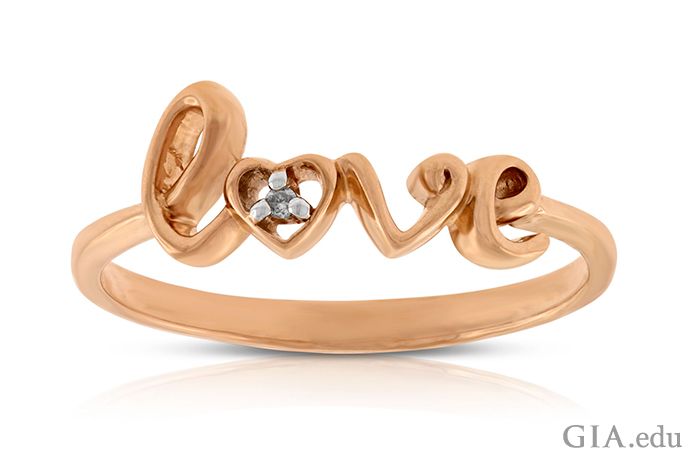 This promise ring set in 14K rose gold contains 0.006 carats of diamonds.