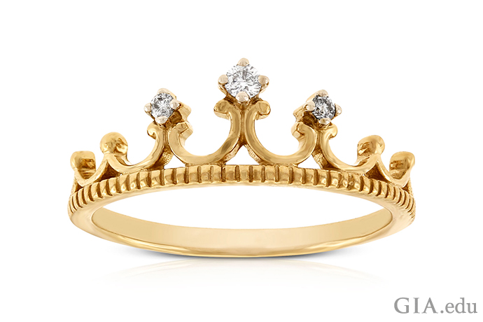 A crown-motif ring made with 14K yellow gold and set with 0.16 carats of diamonds.