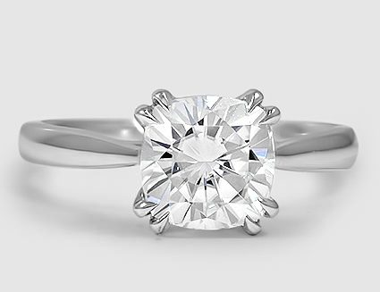 18K white gold ring is set with a colorless synthetic moissanite.
